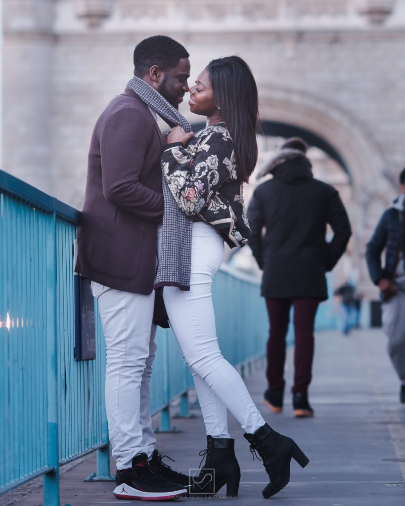 engagement couple standing on the London Bridge